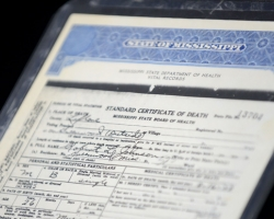 A certified death certificate for blues legend Robert Johnson is on display at the University of Mississippi's J.D. Williams Library throughout the summer. Johnson's poorly documented life and death gave rise to the myth that he sold his soul to the devil. UM photo by Nathan Latil.