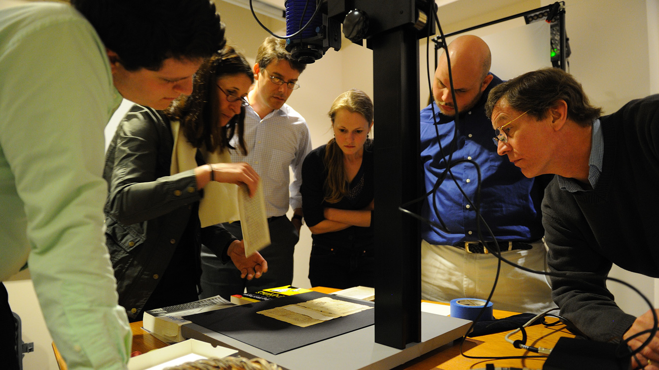 Renate Mesmer (second from left), head of conservation at the Folger Shakespeare Library, repositions the 'Archaionomia' under the imaging camera as (left to right) Mitchell Hobbs, Gregory Heyworth, Kristen Vise and Andrew Henning, all of the University of Mississippi, and William A. Christens-Barry, chief scientist with Equipoise Imaging, watch. UM photo by Robert Jordan.