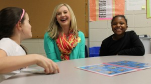 Oxford Elementary students Brianna Lyons (left) and Makenzie Robinson (right) work with Jessica Simpson on a grammar center aligned with Common Core State Standards.