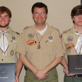 Brothers Bryce Akins (left) and Brant Akins (right), accompanied by their father and scoutmaster, Sean Akins, show off their Eagle Scout scholarship awards from the University of Misissippi at the Yocona Area Council's recent Youth Recognition Banquet. The Ripley natives, members of Troop 38, both plan to attend Ole Miss. Photo by Mitchell Diggs