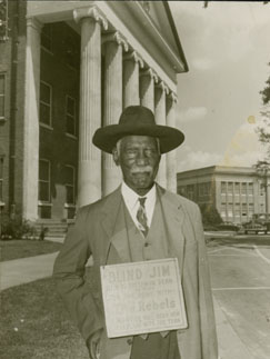 """Blind"" Jim Ivy in front of the Lyceum at UM in this undated photo."