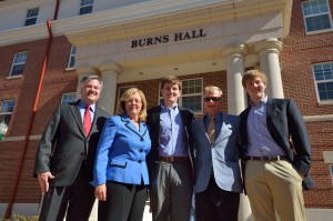 Roland Burns with wife, Sheryl, son Derek, Ole Miss Accountancy Professor Jimmy Davis and son Tyler stand in front of the newly dedicated Burns Hall. Roland and Derek shared Davis as a professor while at Ole Miss, and youngest son, Tyler will be taking a class Davis is teaching this fall.