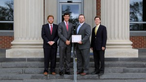 Patrick Everman, chair of the Negotiation Board and student coach; Drew Taggart; Brad Cook; and Professor Mercer Bullard, faculty coach
