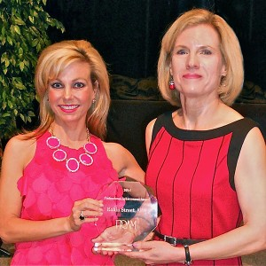 Robin Street, (on right) Meek School of Journalism and New Media lecturer, who coordinates the School's PR program, was presented the Professional Achievement Award from the Public Relations Association of Mississippi by PRAM President Shannon Coker. The award, given to one PR professional yearly, is given for outstanding achievements in the profession of PR.