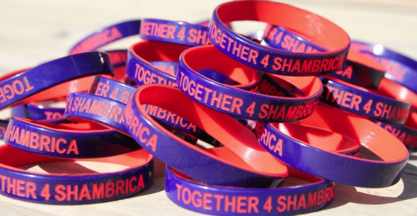 "Six teams of MBA students are raising funds to purchase a new wheelchair for a Mississippi teen. ""Together4Shambrica"" wristbands are available online and at a tennis event Friday."