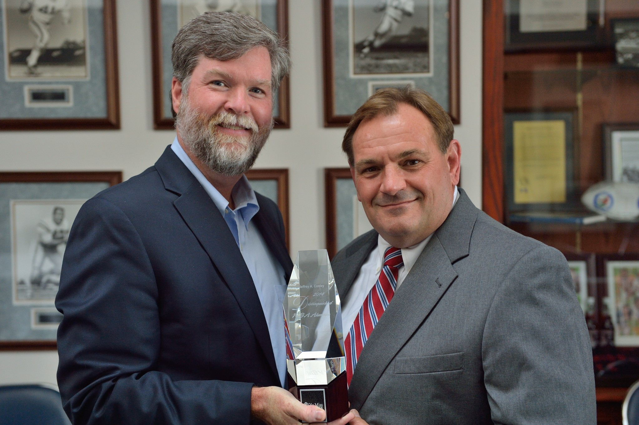 Dean Cyree (left) presents the award to Photo by Kevin Bain/Ole Miss Communications