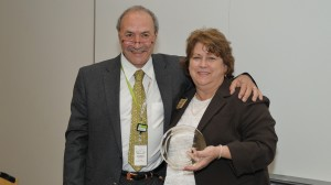 Toni Scarpa, director of NIH's Center for Scientific Review, poses with Alice Clark after presenting her with the center's 2010 Marcy Spear Outstanding Reviewer Award for her 20-year commitment to reviewing NIH grant proposals.
