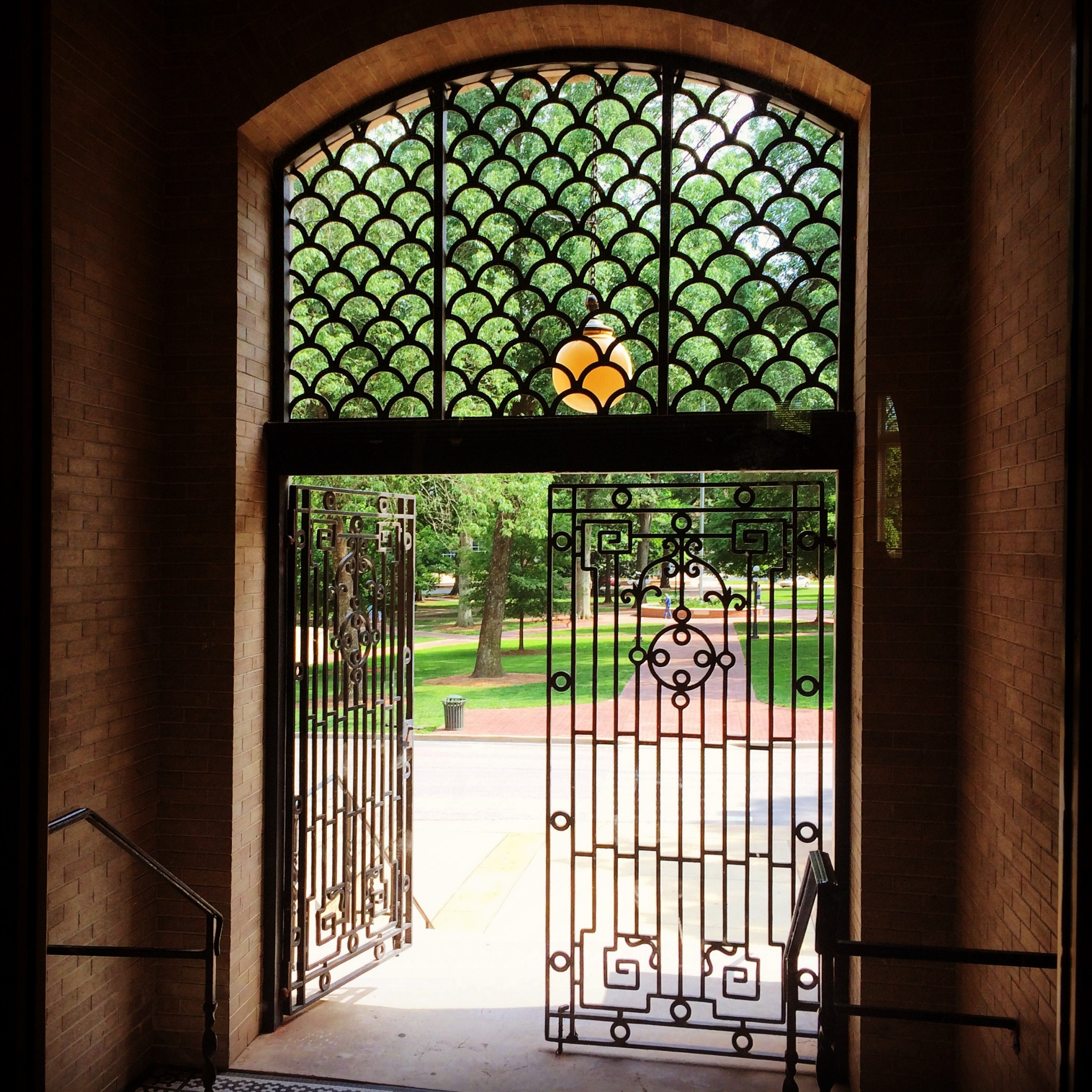 The fancy ironwork entrance to Bryant Hall faces the Lyceum Circle. Photo by Michael Newsom