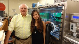 Dr. Hussey with one of his students.
