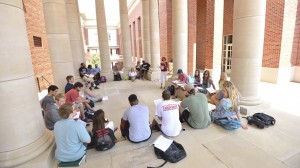 Students gather for class outside of Holman and Connor Halls.
