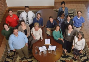 The University Communications staff gathers around with recent awards.