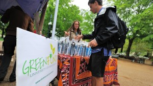 Sydney Crimmins sells a water bottle to Forrest Gamble during Green Week.
