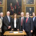 Representatives of the University of Mississippi Medical Center and the Mayo Clinic on Tuesday signed an agreement to broaden and deepen their collaboration in clinical trials, other medical research, and education. Taking part in the signing at the Mayo Clinic in Rochester, Minnesota were (from left) Dr. Robert Rizza, Mayo Clinic liaison for the collaboration; Dr. Dan Jones, University of Mississippi chancellor; Dr. James Keeton, UMMC vice chancellor for health affairs and dean of the School of Medicine; Dr. LouAnn Woodward, UMMC associate vice chancellor for health affairs and vice dean of the School of Medicine; Dr. Richard Summers, UMMC associate vice chancellor for research; Dr. Gregory Gores, Mayo Clinic executive dean for research; Scott Kaese, Mayo Clinic operations administrator for research; and Steven C. Smith, Mayo Clinic chairman of the  Department of Research Administration.