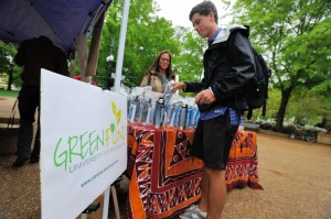 Sydney Crimmins sells a water bottle to Forrest Gamble during Green Week.  Photo by Kevin Bain/Ole Miss Communications