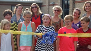 "Della Davidson Elementary School student Molly Cat Tannehill, center, cuts the ribbon on the new student garden with students Stella Wilkins, Wes Carwile, Julia Dennis, Patrick Murphy and Walker Repka. Tannehill won the contest to name the garden ""Food for Thought."" She is joined by Good Food for Oxford Schools program director Sunny Young, projects coordinator Lauren Williams, Food Corps service member Mallory Stefan, Good Food voluteer Katelynn Dillard and Kathy Knight, associate professor in the Nutrition and Hospitality Management Department at the University of Mississippi."