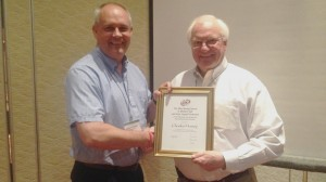 "Charles ""Chuck"" Hussey (right) was presented the Electrochemistry Society's Max Bredig Award in Molten Salt and Ionic Liquids by Robert Mantz, chair of ECS' Physical and Analytical Electrochemistry Division. (Submitted Photo)"