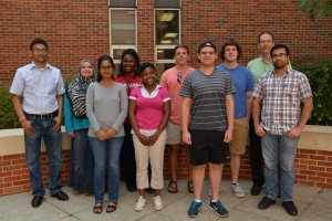 Ashlee Colbert (front row, center) and Michael Concepcion-Santana (front row, right) with Robert Doerksen (back row, far right) and his research group.