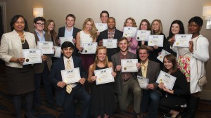 University of Mississippi print and broadcast journalism students proudly display awards won at the Southeast Journalism Conference competition.