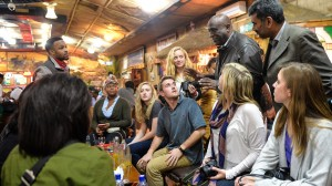 University of Mississippi students enjoy a meal at a restaurant in Addis Ababa while hearing from AAU President, Dr. Admasu Tsegaye, about cultural relationships between various dances and Ethiopian cuisine.