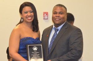 Ryan Upshaw receives the Outstanding Faculty and Staff Award from Briana O'Neal, president of the UM Black Student Union.