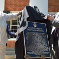 Ms. Martha Dowd Dalrymple and Chancellor Dan Jones unveil the Arch Dalrymple III Department of History plaque at a dedication ceremony. Photo by Robert Jordan/Ole Miss Communications