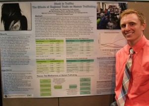 Jacob Smith presents his research on human trafficking at the National Science Foundation Research Experience for Undergraduates in Civil Conflict Management and Peace Science at the University of North Texas.