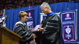 Dr. Brandi Hephner LaBanc presents Dr. Luca Bombelli with the Frist Student Service Award. Photo by Kevin Bain.