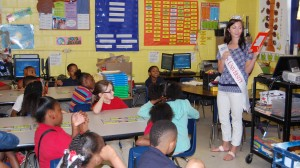 Miss University France Beard reads to a second grade class at Quitman Elementary School.