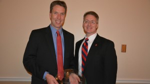 Dean David D. Allen (right) presents Jeffery Steevens with the Distinguished Alumnus of the Year award.