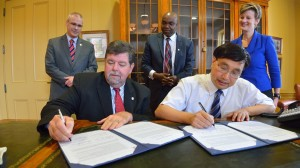 University of Mississippi Provost Morris Stocks, left, and North China University of Technology Vice President Luo Xueke, right, sign an educational collaboration agreement.