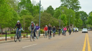 Cyclists ride along University Avenue, where a Complete Streets Pop Up will be installed for the month of July. Photo by Robert Jordan/Ole Miss Communications