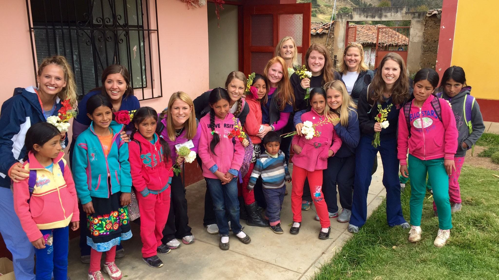 Pharmacy students interact with Peruvian children while on a medical mission trip.