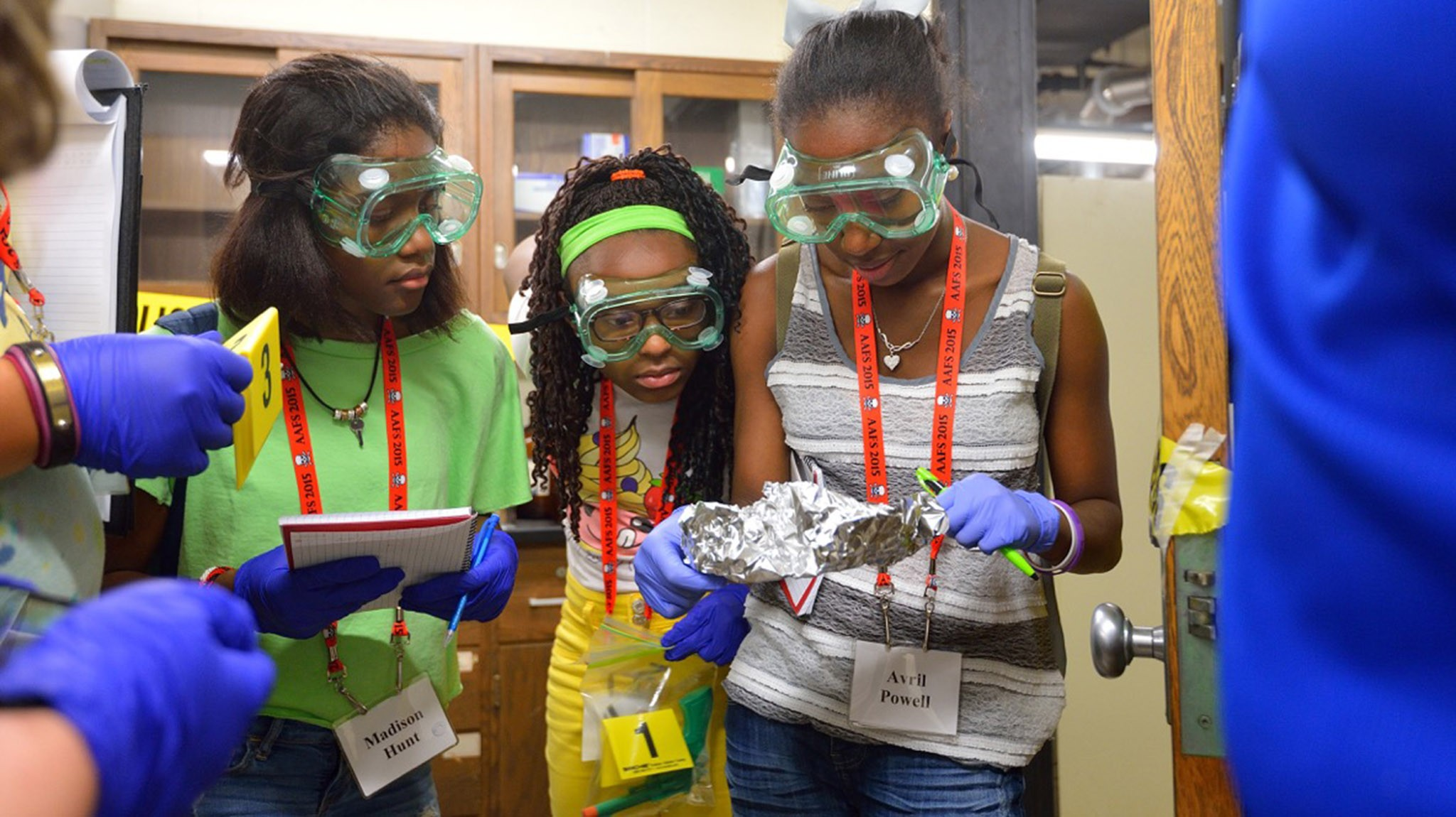 CSI Summer Camp participants look for potential evidence in a staged crime scene. Photo by Robert Jordan/Ole Miss Communications