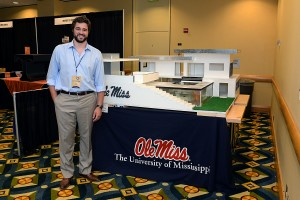 Clay Wooley stands beside his exhibit displayed at the SEC Symposium.