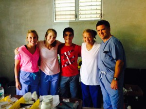 The School of pharmacy team poses for a photo with Copan resident Antony (center).