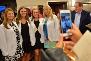 The white coat is a symbol of professionalism in the health care field.