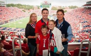 Bill Jordan, his wife, Shannon, and their children – Tyler, a senior at Ole Miss, Graycen, 9, and Colton, 6 – enjoy a football game together in Vaught-Hemingway Stadium. Photo by Bill Dabney