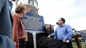 """Mark Camarigg, publications manager of Living Blues magazine, Jim O'Neal, co-founder of LB, Brett Bonner, LB editor, and Scott Barretta, Highway 61 Radio host unveil the Blues Marker honoring """"Living Blues"""" magazine which is published at The University of Mississippi."""