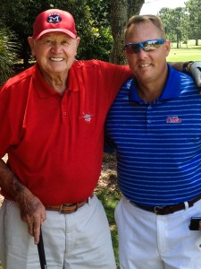 Dr. Gerald 'Doc' Hollingsworth (left), a longtime donor to UM athletics, spends time with head football coach Hugh Freeze.