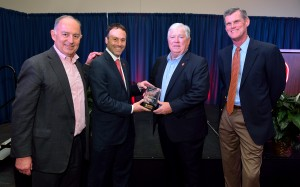 Former Mississippi Gov. Haley Barbour, second from right, receives the 2015 Distinguished Alumnus Award from the University of Mississippi Department of Political Science. Congratulating him are, from left, Lanny Griffith, chair of the Ole Miss Political Science Alumni Advisory Board; Lee Cohen, dean of the College of Liberal Arts; and John Bruce, chair of the political science department. An initiative to fund a chair in Barbour's name in the department is underway, with the study's focus on the American political system. Photo by Thomas Graning/Ole Miss Communications