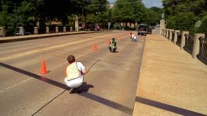 Civil engineering graduate students take vibration measurements on Ford Center Bridge.