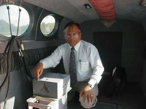 UM civil engineering professor Waheed Uddin checks data using his ground penetrating radar system.