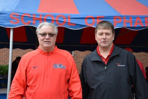 Cardinal Health representatives Robert Clift (left) and Danny McAnally help organize an alumni tailgate for the School of Pharmacy.