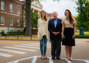 Ed Meek greets 2015 Bill and Jean May Mississippi Sun scholars HartLee Gabbert (left) and Lyndy Berryhill in front of the UM Meek School of Journalism and New Media. The scholarship honors longtime friends of Ed and Becky Meek.