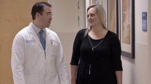 Dr. Kenneth Vick, associate professor of surgery and a key player in the growth of UMMC's bariatric surgery program, chats with patient Chanci Stewart of Ridgeland, who lost 140 pounds after undergoing bariatric surgery at UMMC.