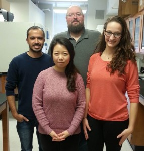 UM Biology Professor Patrick Curtis makes time for his graduate students in his laboratory.