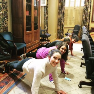 The HR team begins their first session with a warm-up plank