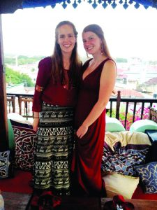 Gracie Snyder (left) and Crissandra George attend a rooftop dinner in Zanzibar, an archipelago off the east coast of Tanzania, where the group learned about Tarab traditions, which are a mix of Arabic and Swahili cultures. Snyder and George were among 12 UM students who visited East Africa this summer as part of a study abroad course. Photo courtesy Crissandra George