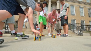 Jim Chambers helps high school students race their solar-powered cars during an engineering camp that he helped launch. Photo by Kevin Bain/Ole Miss Communications