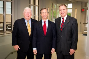 Former Mississippi Gov. Haley Barbour (left) visits with Mayo Flynt, president of AT&T Mississippi, and UM Chancellor Jeffrey Vitter on the Ole Miss campus. Photo by Bill Dabney, UM Foundation